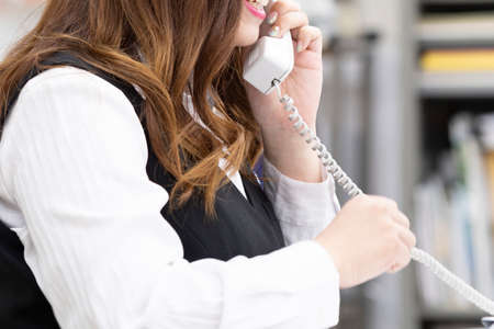 A woman talking to a customer on the phone