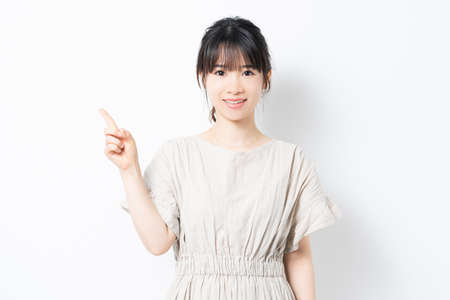 Young woman showing point with forefinger