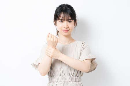 Young woman showing wrists shot in studio