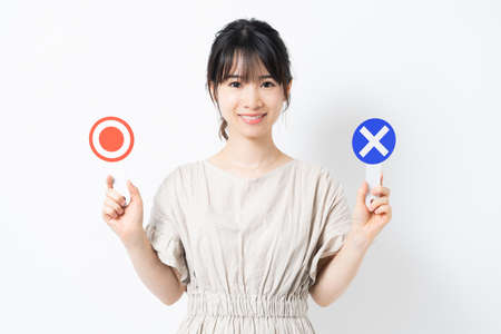 young woman with ok and ng placard Stock Photo