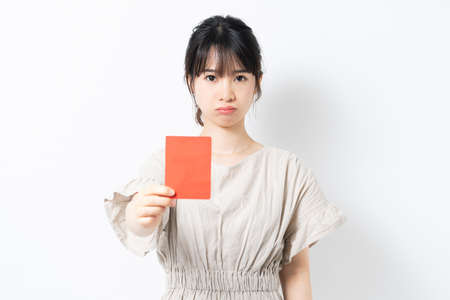 Young woman giving a red card