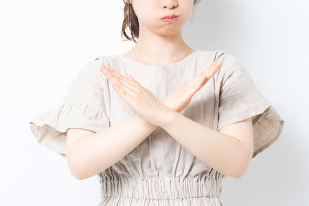 Young woman making an NG gesture shot in the studio