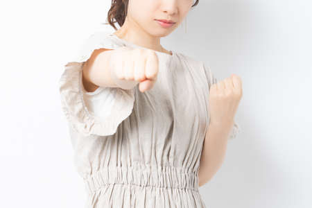 Young woman doing a punch pose 写真素材
