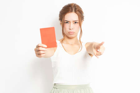 Young woman holding a red card in her hand Stockfoto