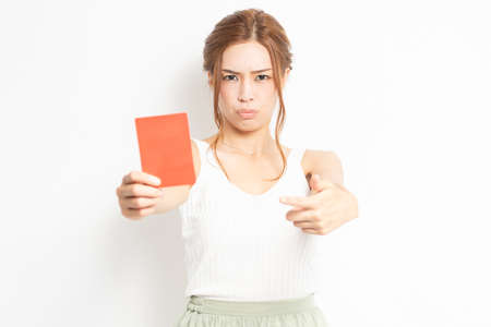 Young woman holding a red card in her hand 写真素材