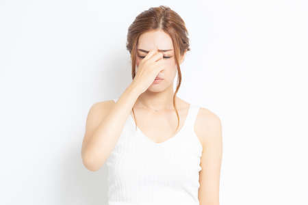 Young woman suffering from tired eyes