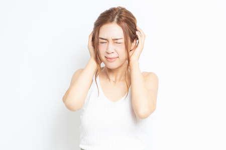 Young woman hiding ears shot in studio 免版税图像