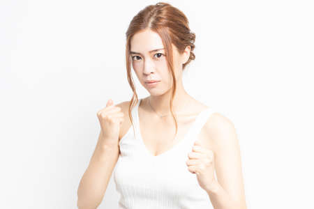 Young woman making a fighting gesture 写真素材