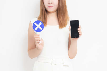 Young woman with a smartphone shot in the studio
