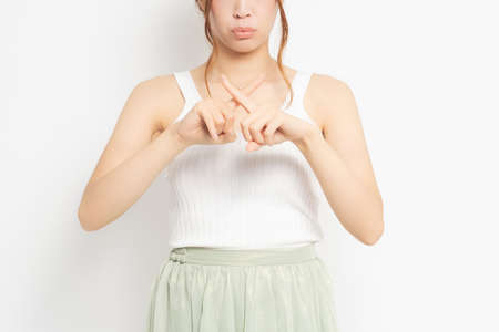 Young woman making an NG gesture 写真素材