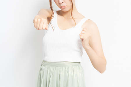 Young woman doing a punch gesture 写真素材