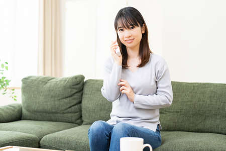 Young woman calling in the living room