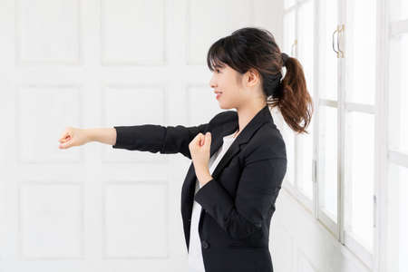 Young woman doing punching gesture shot in studio