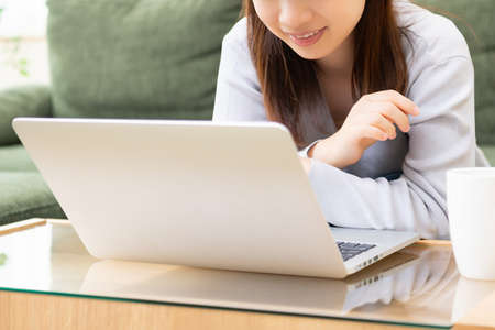 A young woman using a laptop shot in the studio