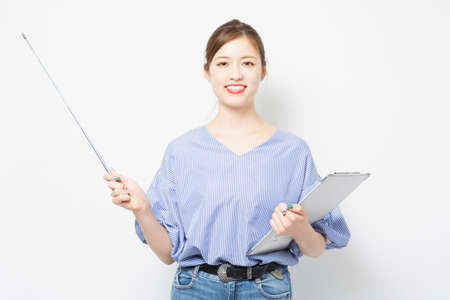 A young woman showing points with a pointer taken in the studio