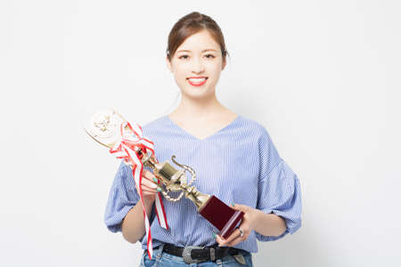 Young woman with a trophy shot in the studio