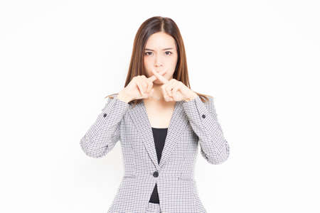 Business woman making NG gestures shot in the studio