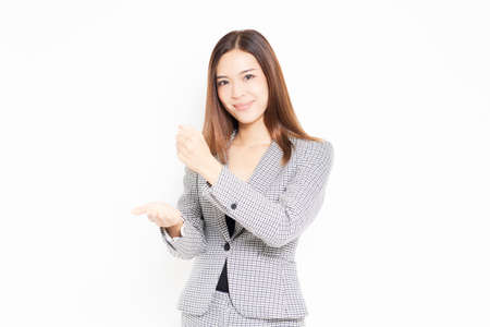 A business woman who makes a convincing gesture shot in the studio