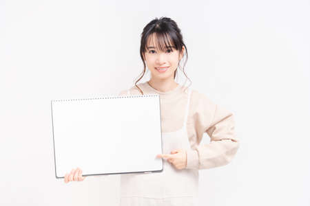 Young woman with a large sketchbook taken in the studio