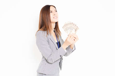 A business woman holding money shot in the studio