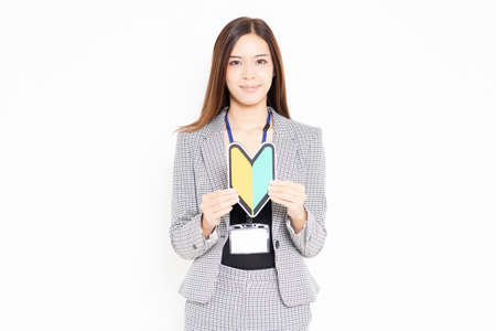 Business woman with a beginner's mark shot in the studio