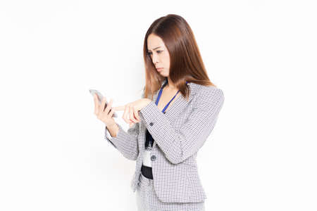 Business woman using a smartphone shot in the studio