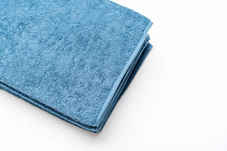 Blue face towel taken on a white background