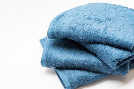Blue bath towel taken on a white background