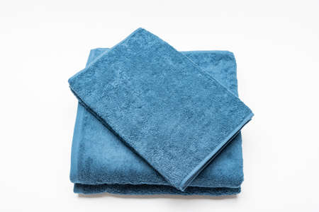 Blue bath towel and face towel taken on a white background 版權商用圖片