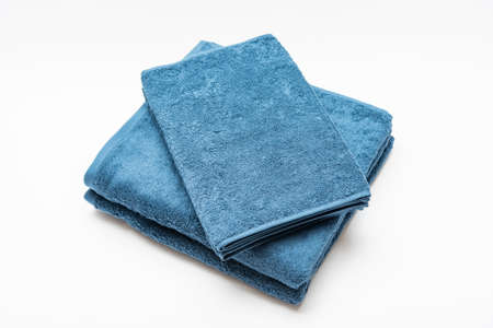 Blue bath towel and face towel taken on a white background