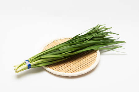 Chinese chive placed on a bamboo basket, taken in the studio