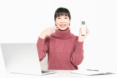 Woman holding a telephone handset taken in the studio Reklamní fotografie