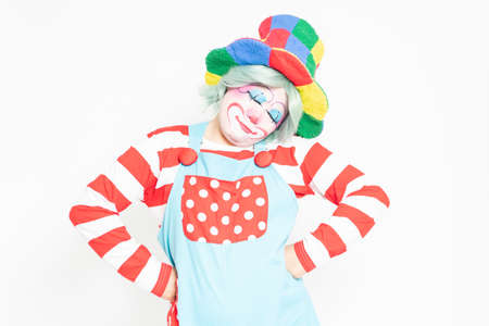 Clown making a gesture to think in front of a white background