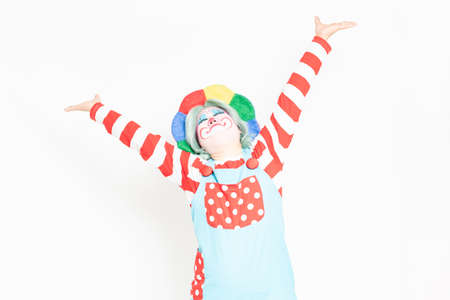 Clown taking a deep breath in front of a white background