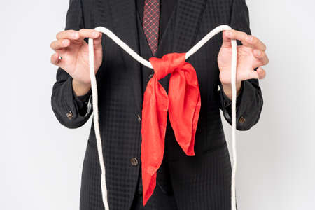 A magician who does magic tricks with a rope and a handkerchief Stock fotó