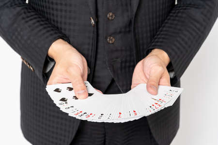 Hands of a magician playing card magic with playing cards Stock fotó