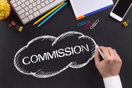COMMISSION written on Chalkboard