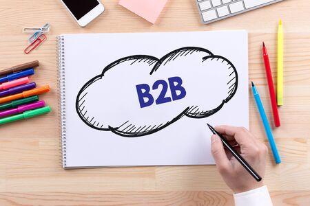 b2b: Man with a Notepad written B2B Concept