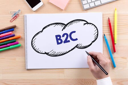 b2c: Man with a Notepad written B2C Concept