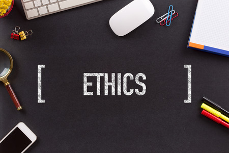 work ethic responsibilities: ETHICS CONCEPT ON BLACKBOARD Stock Photo