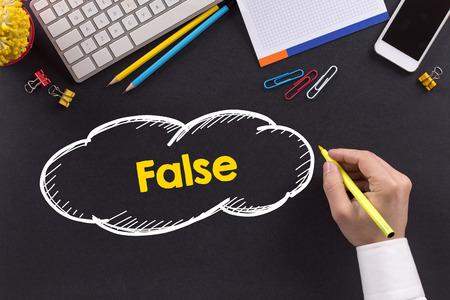 untrue: Man working on desk and writing False