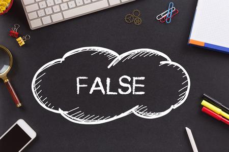 untrue: FALSE written on Chalkboard