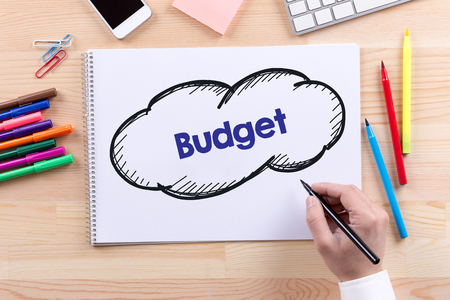deficit target: Man with a Notepad written Budget Concept Stock Photo