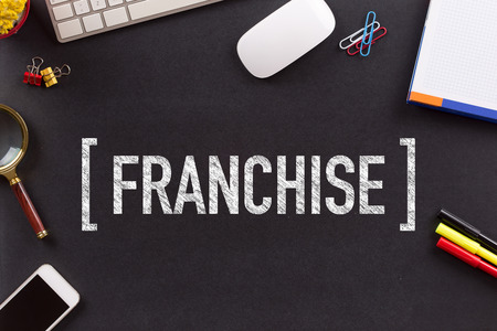 franchising: FRANCHISE CONCEPT ON BLACKBOARD Stock Photo