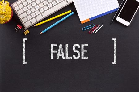 untrue: FALSE CONCEPT ON BLACKBOARD Stock Photo