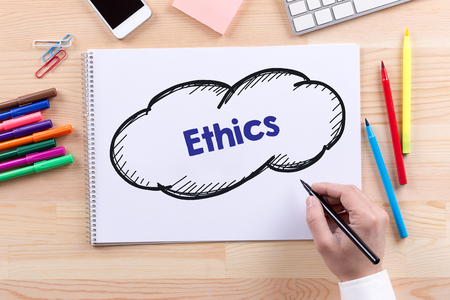 work ethic responsibilities: Man with a Notepad written Ethics Concept