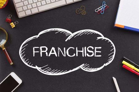 franchising: FRANCHISE written on Chalkboard Stock Photo