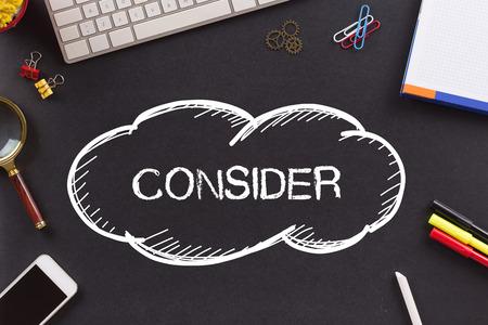 consider: CONSIDER written on Chalkboard Stock Photo