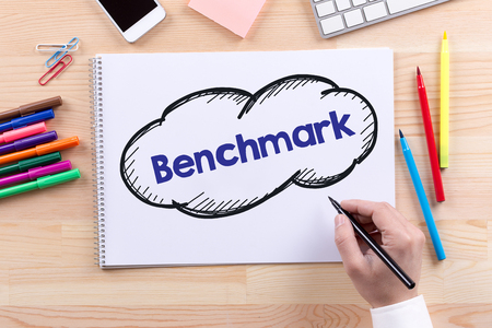 benchmark: Man with a Notepad written Benchmark Concept