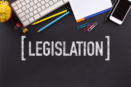 legislation: LEGISLATION CONCEPT ON BLACKBOARD Stock Photo